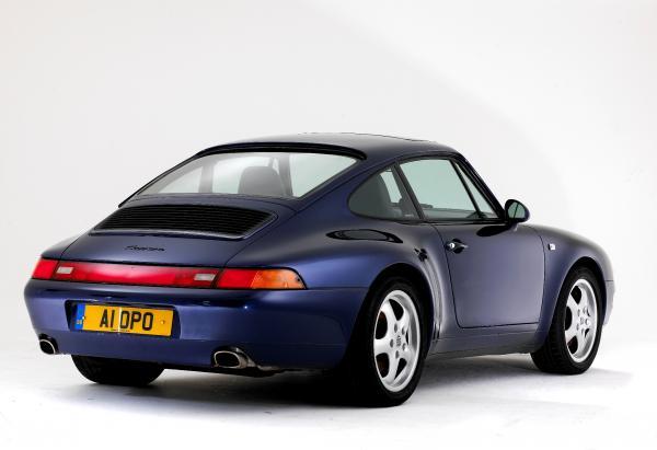 1993 dark blue Porsche 993, seen from behind